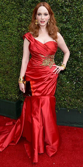 Christina Hendricks on the 66th Primetime Emmys red carpet.  Stunning, sultry in red Marchesa