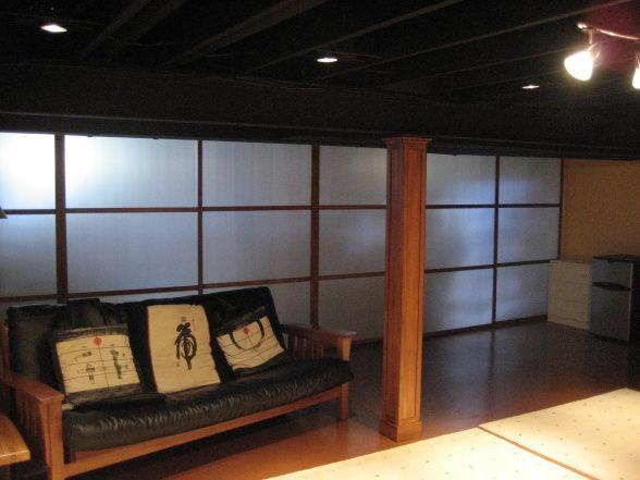 Basement open ceiling painted black with pendant lighting for Black ceiling basement ideas