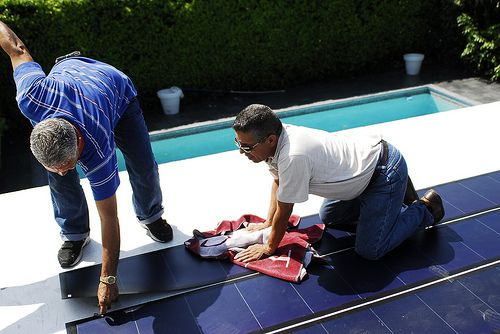 Stretchy solar energy panels. http://solar-panels-for-your-home.co/flexible-solar-panels.html Thin Film Flexible Solar PV Installation 6