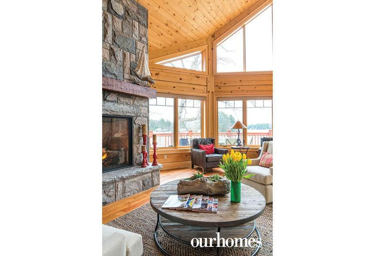 """This rustic wood and metal coffee table is a favourite place to gather and watch the fire on quiet mornings.    See more of this home in """"Fifth Generation Legacy on Muskoka's Moon River"""" from OUR HOMES Muskoka Early Summer 2017: http://www.ourhomes.ca/articles/build/article/fifth-generation-legacy-on-muskokas-moon-river"""