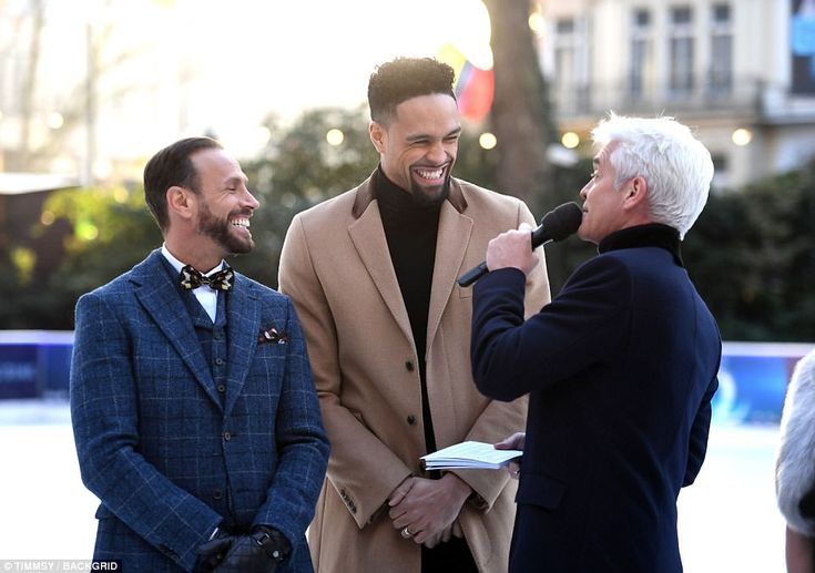 Having a great time: Host Phillip Schofield (right) happily chatted to judges Jason Gardiner and Ashley Banjo at the event