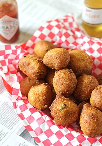Hushpuppies:  1 2/3 cups cornmeal, finely ground  1/3 cup unbleached all-purpose flour  2 teaspoons baking powder  1/2 teaspoon baking soda  1 Tablespoon granulated sugar  1/4 teaspoon freshly ground black pepper  3/4 teaspoon kosher salt  1/8 teaspoon ground cayenne pepper  2 extra large eggs  1 cup buttermilk  2 green onions