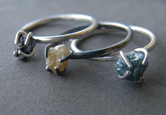 This solitaire ring features one amazing green Diamond, firmly held by handmade sterling silver prong settings.  This African diamond is CONFLICT FREE.  Raw gemstone jewelry are fascinating and unique, as each stone has a different shape and history, and that's what makes this ring a unique