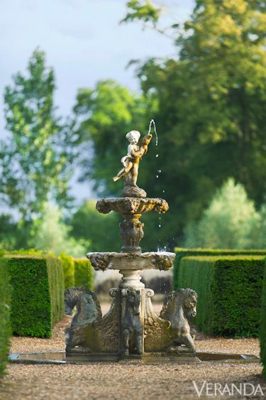 "In the formal garden, hedges define ""rooms,"" some with architectural features such as fountains."