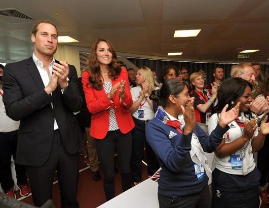 Prince William, Duke of Cambridge and Catherine, Duchess of Cambridge applaud the gold medal victory by the Team GB Men's Team Pursuit in the Track Cycling on Aug. 3, 2012 in London, England. (John Stillwell/Getty Images)