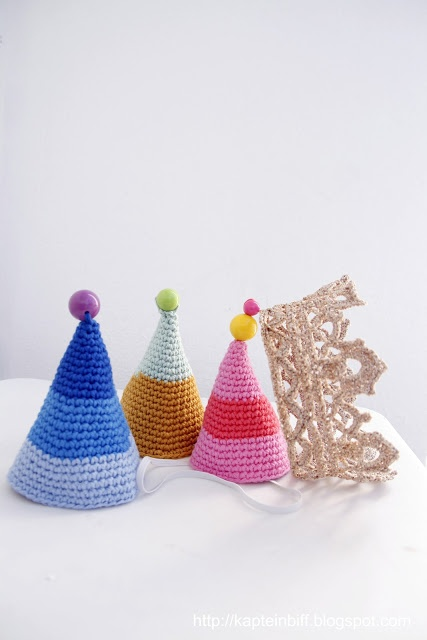 knitted and glittered party hats