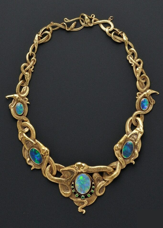 Art Nouveau 18kt Gold, Opal, and Demantoid Garnet Necklace, designed as writhing serpents with five bezel-set opals, the central opal with demantoid garnet accents,maker's mark RD within a shield.