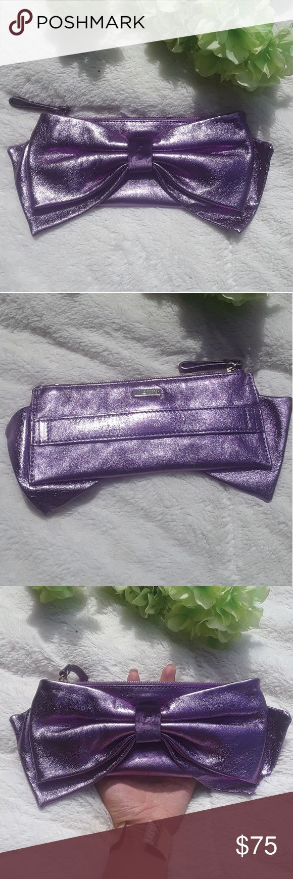 "KATE SPADE METALLIC PURPLE CLUTCH This Kate Spade clutch is hard to find!! Super adorable and in great condition! Inside and and are both very clean! Metallic purple 8 1/2"" length w/ out bow 11"" w/ bow kate spade Bags Clutches & Wristlets"