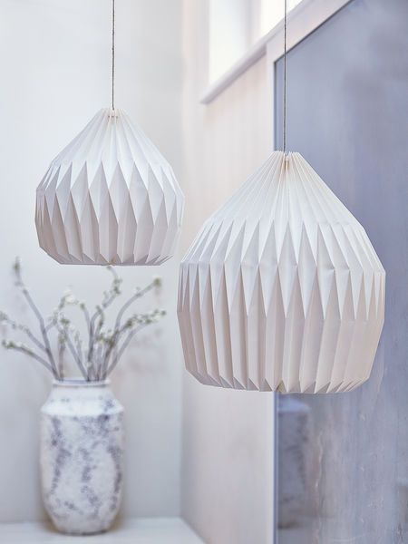 We chose these contemporary lampshades as they are so in tune with this season's passion for geometrics.