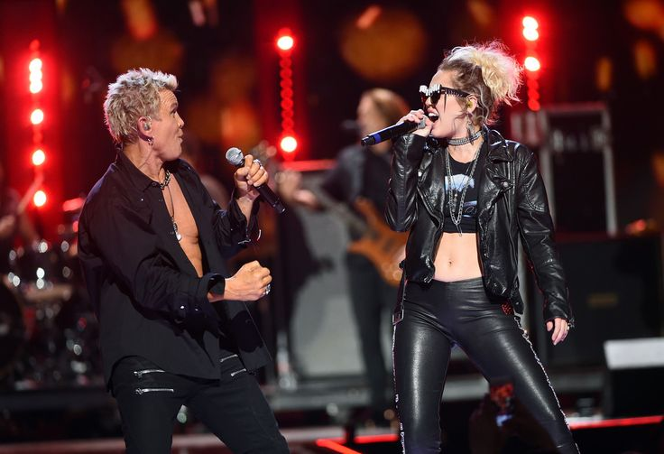 Miley Cyrus hits the iHeartRadio Music Festival Stage with Billy Idol