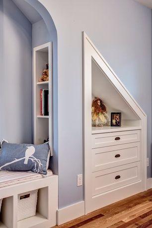 Craftsman Kids Bedroom with High ceiling, Navy Blue Bird on Cherry Blossom Pillow, Built-in bookshelf, Hardwood floors