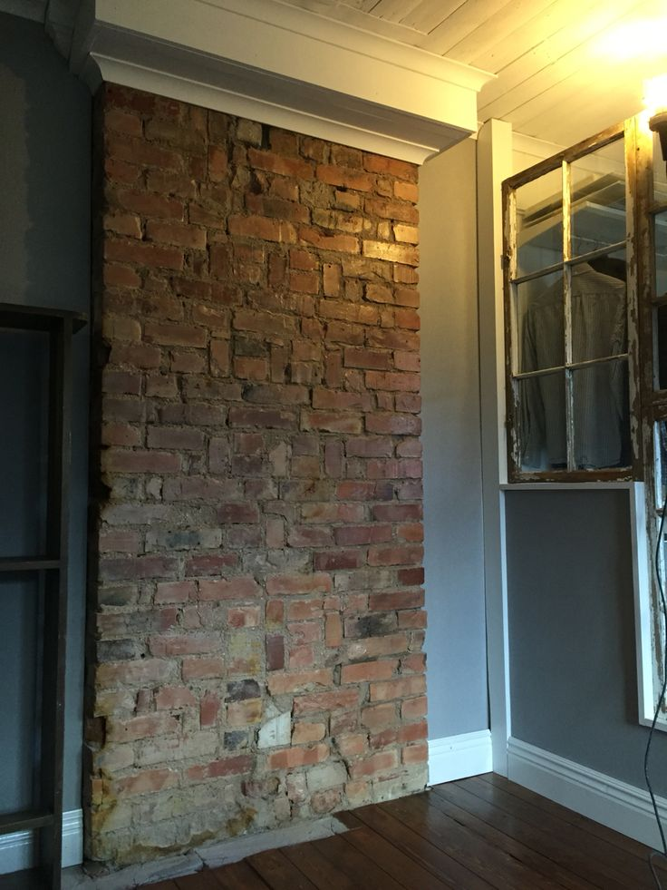 Love my brick wall in our bedroom!