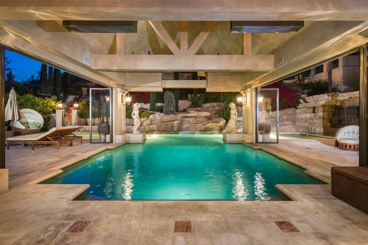 Tour a european style villa with a palatial pool to be backyard retreat and mansions for Rocky mountain house swimming pool schedule