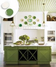 To keep this complementary color scheme from skewing too Christmasy, kitchen designer Carlie Korinek chose soft, muted tones. Wood finishes on the island, ceiling, and floor warm up the overall palette even more.  For a similar look, try: Lady Bug Red (red) and Grasslands (green), Benjamin Moore  Design: Carlie Korinek; arizonadesigns.net