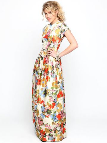 Mad Men gone wild.Metallic brocade printed long dress. Fully lined. Entertain like January Jones. Hostess with the mostess. Zips up the back. Small cap sleeves. High neck. Raised waistline. Extremely vintage. Extremely chic. Coming back as a CLASSIC due to overwhelming popular demand.  5-6 weeks for delivery.