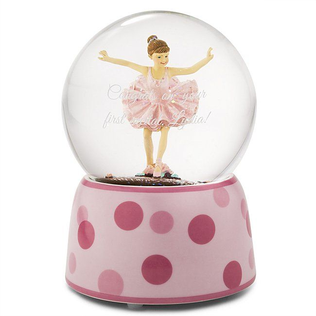 """Whether practicing a plie or mastering her grand jet, she'll always remember to reach for her biggest dreams with our Ballerina Musical Snow Globe. A little girl practicing her positions in a pink tutu sits in the center of the globe and """"Swan Lake"""" plays as the globe is wound."""