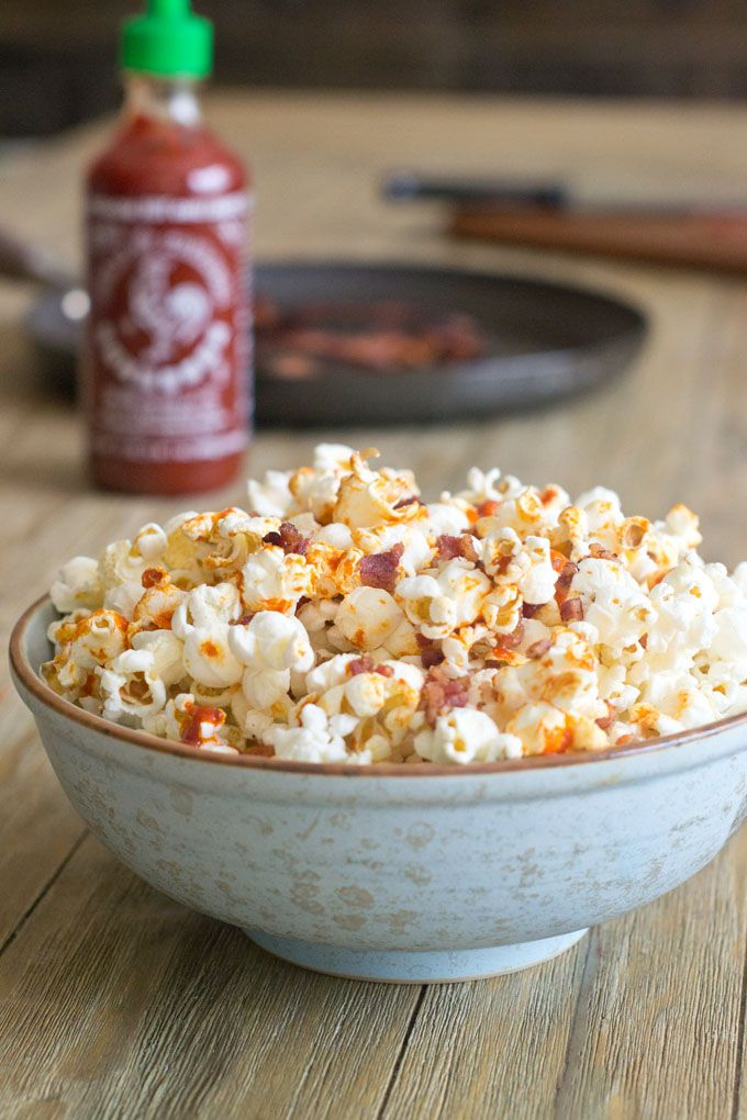 Sriracha Bacon Popcorn Recipe - Cliché alert: We're sticking bacon and Sriracha together and slapping it on popcorn. Oh yes we are!