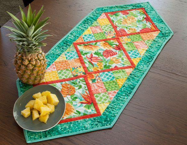 See the making of the Holiday Table Runner sewn up in Connecting Threads' new and exclusive festive fabric, Island Hopping.
