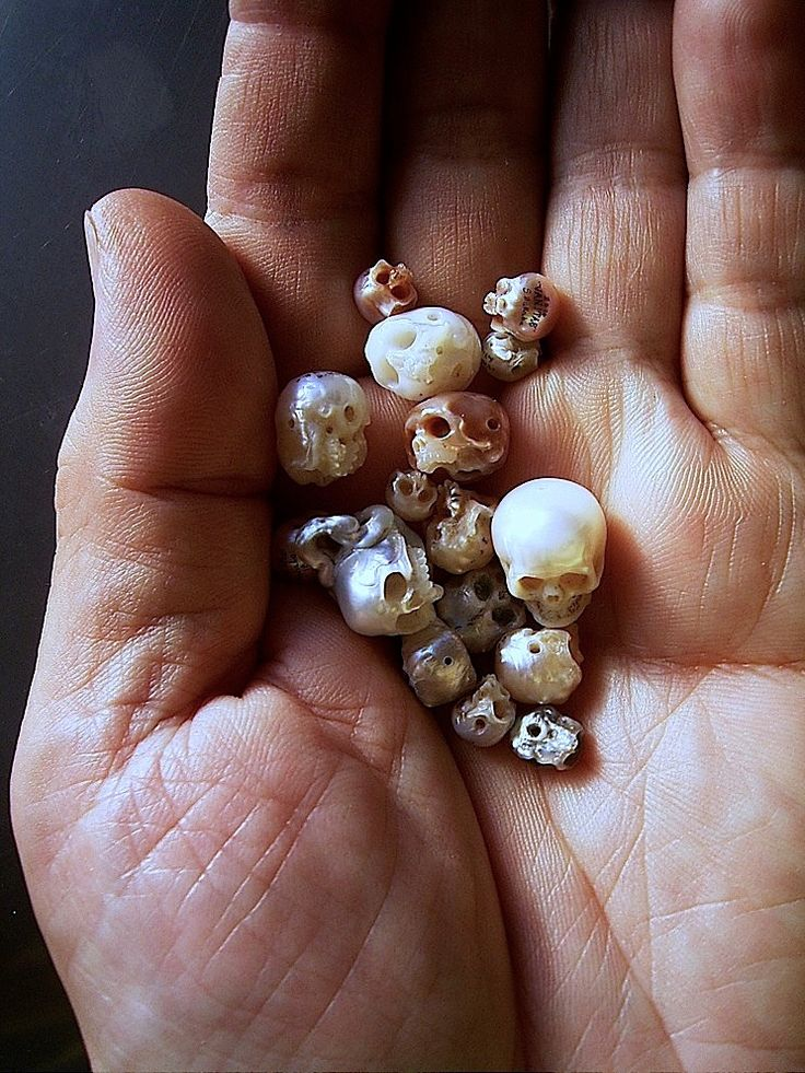 Unique Jewelry Featuring Intricate Tiny Skulls and Faces Carved Into Pearls and Other Found Objects