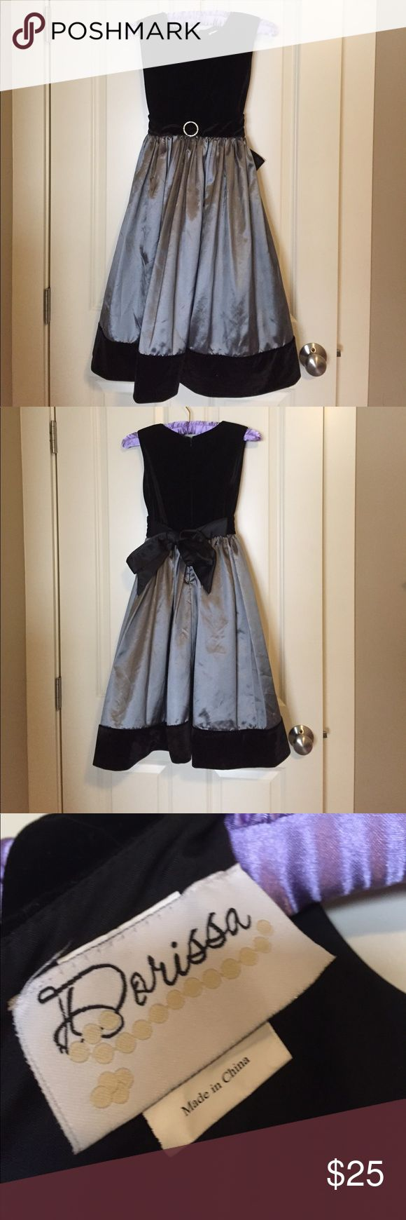 """❤️FINAL PRICE❤️ Gray and Black Girls Dress Dress up your little one! From family photos, to their birthday party, this dress has got you covered! Simple, elegant, classy, and yet - casual enough to make your child want to wear it every day! This dress zips up in the back and features a large black ribbon to tie, it is slightly adjustable in this regard. There is a layer of """"stiff"""" tulle underneath, meaning no one has scrunched it to make it poofy yet! Bundle to save even more! Let me know if…"""