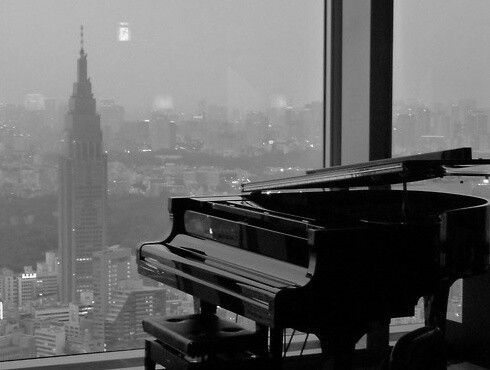 Piano overlooking the skyline.
