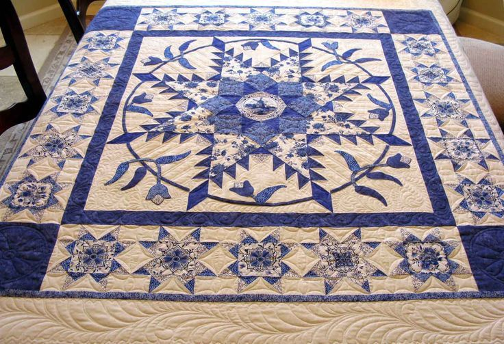 Blue/white feathered star Quilt