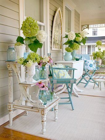 Southern porch of antiques and hydrangea...ahhhh