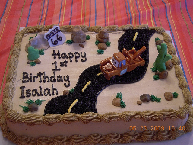 Tow Mater cake (they used crushed oreos for the road)...do something similar to this!!