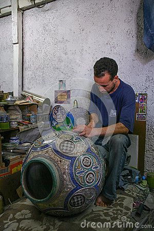 Potter creates a pot in his workshop in Fez - Morocco.