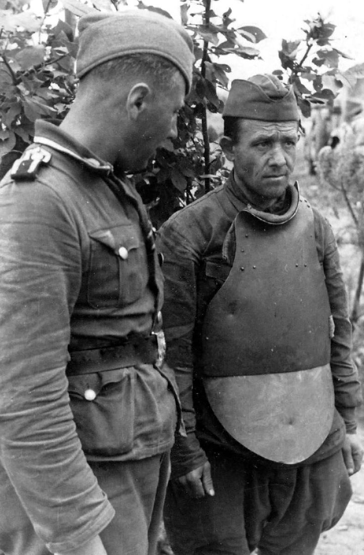 "Soviet POW wearing steel plate body armor identified as ""CH-42."" Note the two dents apparently from bullet impacts. This is a rare photograph of a piece of kit that saw only limited deployment within the Red Army."