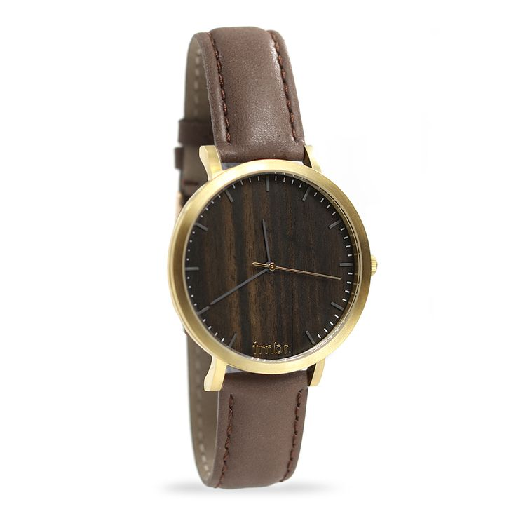 The Tmbr Helm Minimalist Wood Watch made with brushed gold and walnut wood. The 40mm unisex gold wood watch comes with a genuine leather strap and free shipping in the USA.