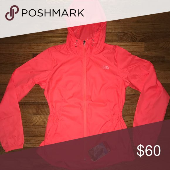 New! Women's North Face Light Coral Jacket sz S New with tags. Color is tropical Coral. Very think Jacket like a windbreaker. The North Face Jackets & Coats