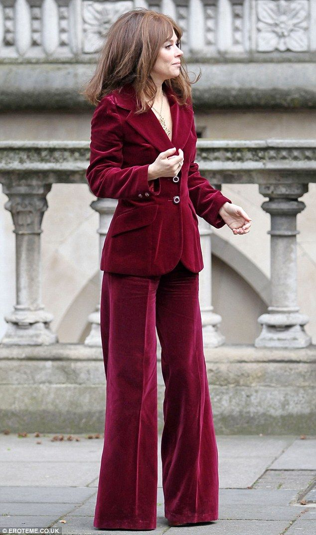 Anna Friel looked every inch the 70s chick in her red velvet trouser suit as she filmed scenes for The King of Soho in London today