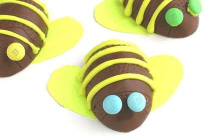 M&M'S Bumble Bees - Some yellow icing and M&M'S eyes make delicious looking bumble bee shaped treats.