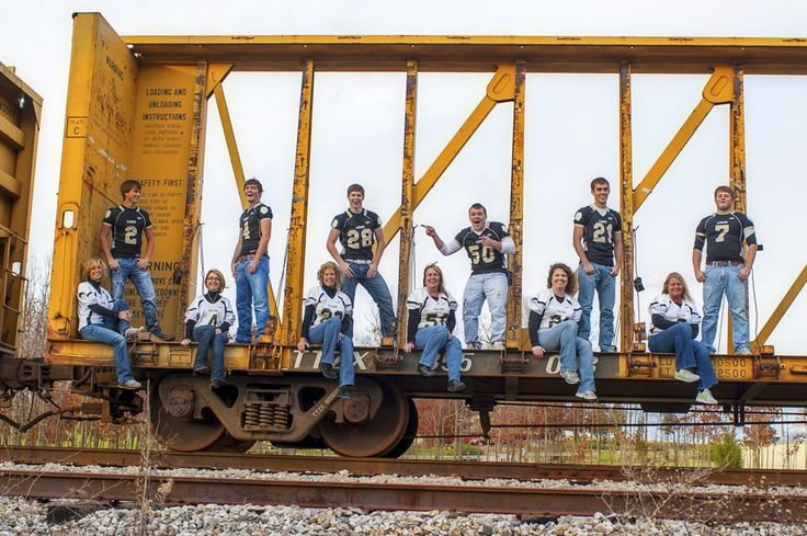 Football Moms with their boys! I LOVE this!I think we should do this for baseball senior night and use the stands or dougout.
