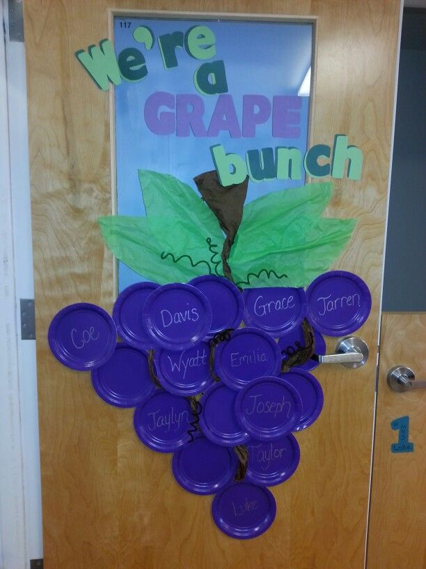 Toddler Preschool classroom door. Eating our alphabet. Exploring the world around us. We're a grape bunch! Fruits and veggies :) 5 senses.