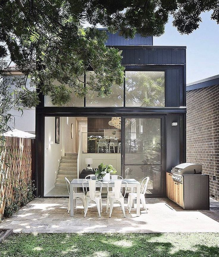 "What was once a single-story 1950's red-brick home in #Petersham, has now been transformed into a two-storey  contemporary four-bedroom home. ""When we built the front splayed facade with the cedar panelling, it quickly became a real hero amongst the black painted exterior cladding,"" says the owners. ""It really made its mark on the street and people would stop and take photos. We knew then, that we had done the right thing."" Head to our bio link to see more or contact Domain for details."