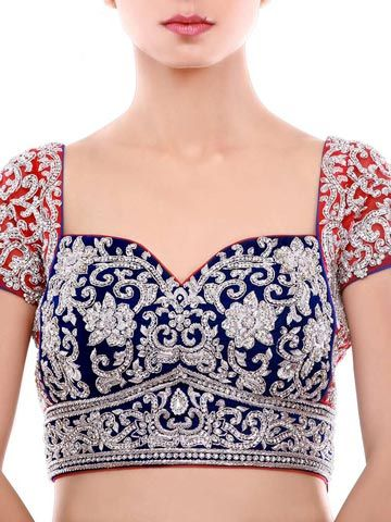 Accentuate Your Ethnic Wear With Exquisite Red & Royal Blue Velvet Blouse, Enhanced With Silver Metallic Embroidery and Stones All Over. Beautiful Tassels At the Back. #Sareeblouses #Blouses #DesignerBlouses #BridalWear #BridalClothes