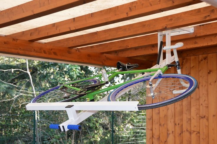 Flat-bike-lift Or How to Park Your Bicycle On The Ceiling [Video] - http://freshome.com/2014/09/02/flat-bike-lift-or-how-to-park-your-bicycle-on-the-ceiling-video/