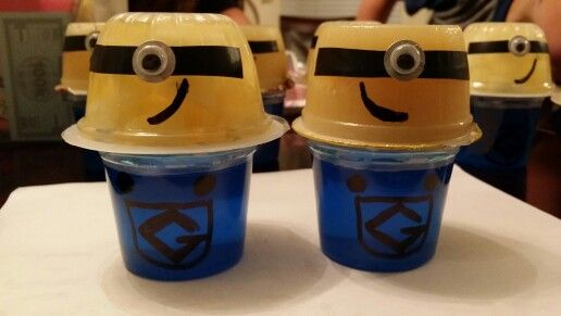 Minion party favors:  Handi-snacks ice blue raspberry jello (4pk) with permanent black marker buttons and pocket drawn and 6-pk applesauce or 4-pk pineapple tidbits cups with black electrical tape for glasses, reinforcement label for silver part of glasses and wiggly eyes added, and draw on half smile/smirk!