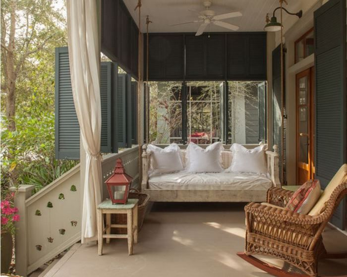 Screened Porch With Swing Bed & Working Porch Shutters at a Beach Cottage via Between Naps on the Porch