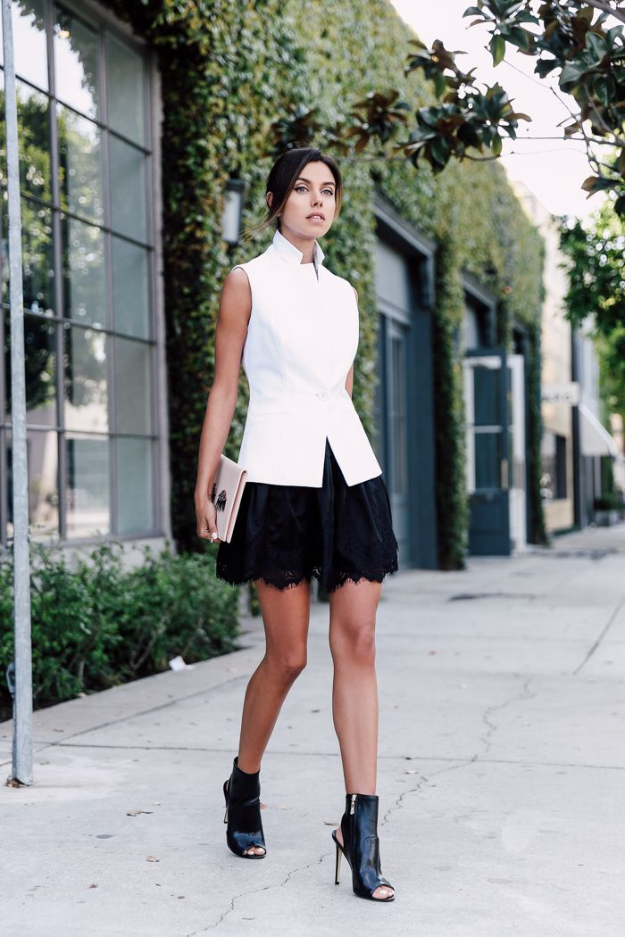 white vest with black skirt and edgy boots