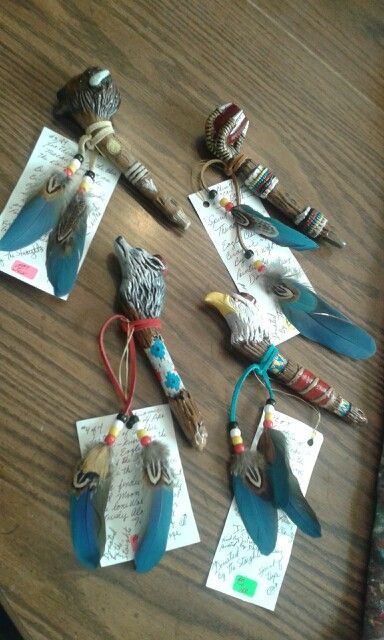 Ceramic pipes accented by rainbow eagle the macaw I made for a bone cancer benifit.
