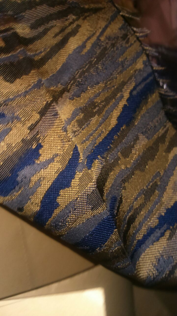 This material is absolutely gorgeous and would be perfect for a summer dress.