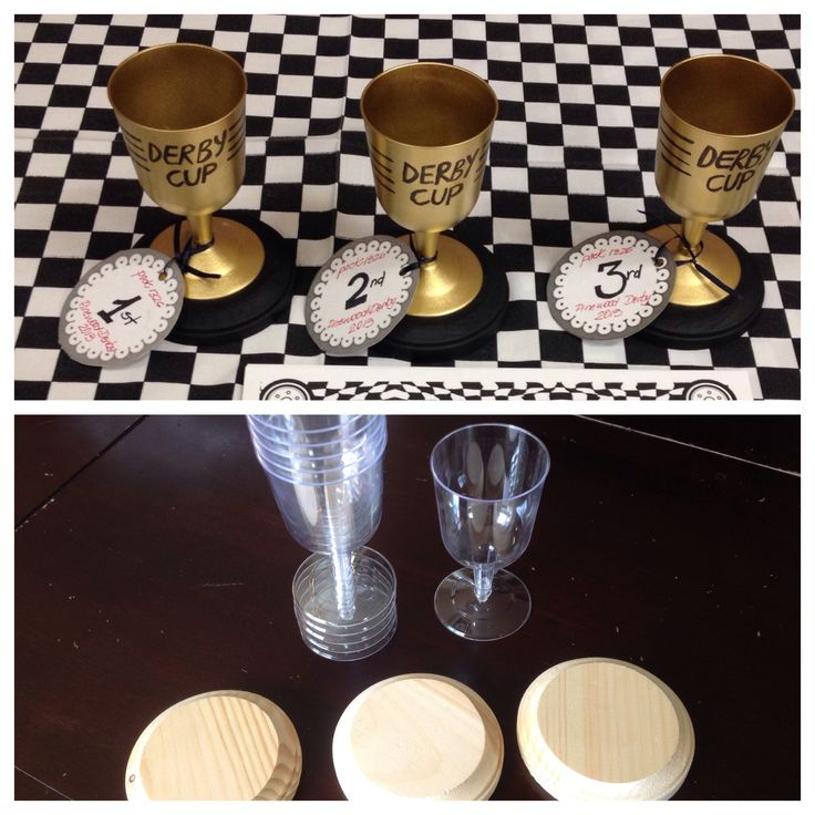 Pinewood Derby 1 for 6 Dollar Tree plastic wine cups .79 ea Hobby Lobby circle plaque 3.77 black spray paint base $3.77 gold spray paint for trophy cup (cups) -hot glue and gun  -black permanent marker -ribbon and paper tags   Spray paint base black, then outside of cups gold. When dry (30 min), hot glue bottom of cup then attach to center of base. Write 'DERBY CUP' on the gold cup. Print tags and write pack number, winner position (1st, 2nd, 3rd), Pinewood Derby and the year