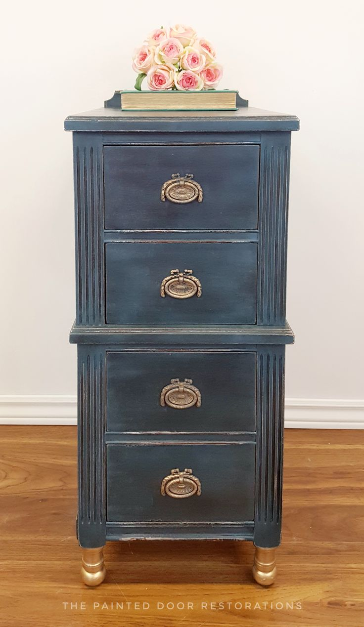 My very first Annie Sloan project! I did this side table in Aubusson Blue with clear and black wax for the detailing.  The hardware was painted to match and they and the legs are then done in Gold Gilding wax.  The entire piece is distressed.