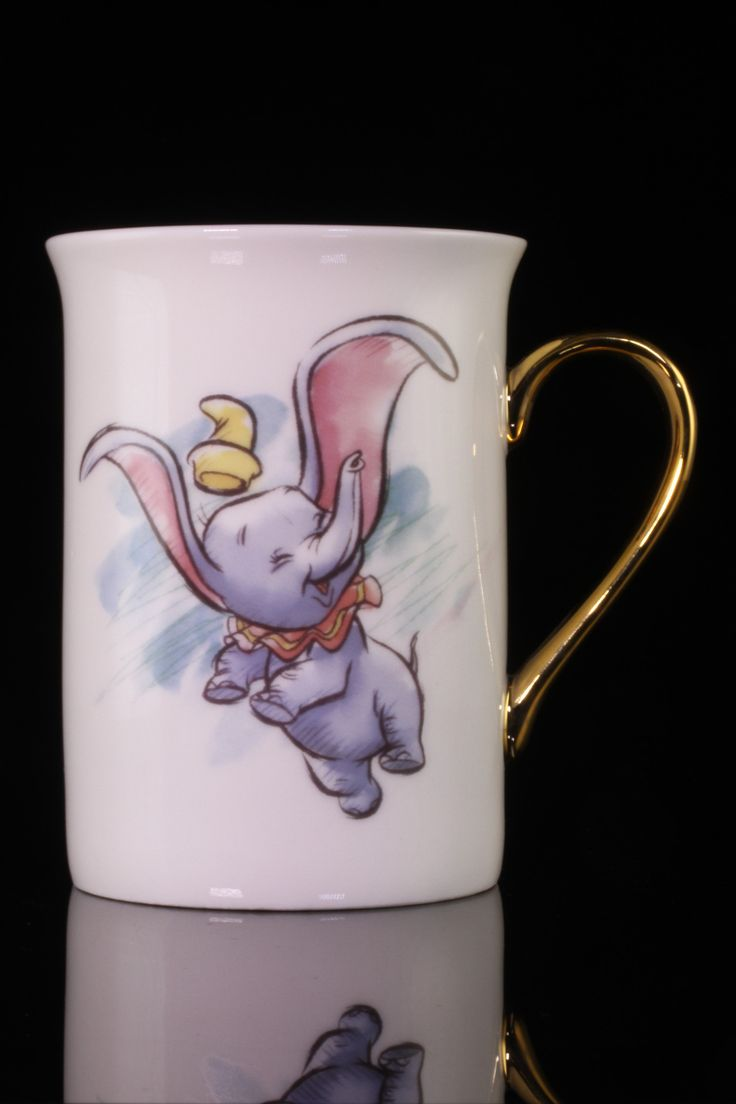 Disney Dumbo Mug. Cute & Cuddly Dumbo. Night Night Little One. Simply Adorable.  Porcelain mug stands 4 inches and is 2 1/2 inches across. Comes packed in gold embossed gift box.