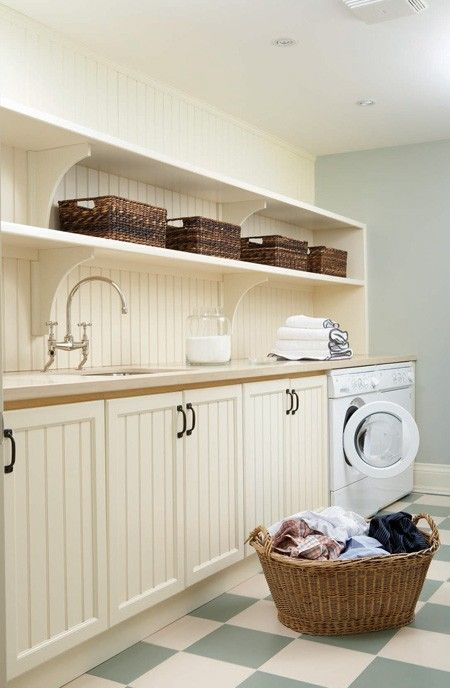 House and Home laundry room with beadboard, open shelving and checkered floor.