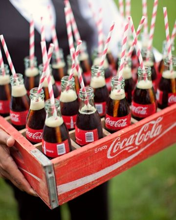 This couple served Coca-Cola in old-fashioned glass bottles passed in wooden crates at their rehearsal dinner.