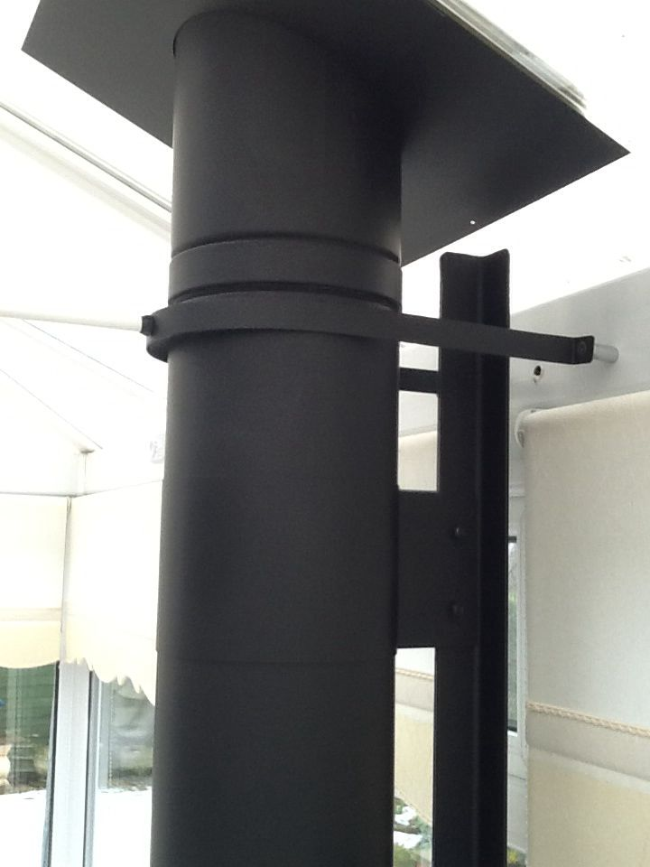 Our own design of bracket supports off the conservatory wall (600mm high), we use coach bolts to attach the lower part of the bracket to the wall then the flue has custom made bands that attach the flue to the bracket. The result is a 'super strong' support and the stove can be removed without dislodging the chimney therefore meeting the regulation requirements